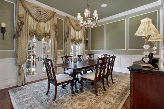 Picture of a luxury dinning room with traditional furniture, green walls with french doors in Jacksonville, FL
